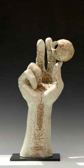 Hand with Pot